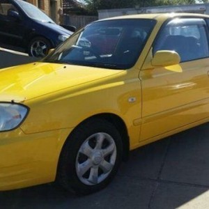 2005 Hyundai Accent LS 1.6 Yellow 5 Speed Manual Hatchback